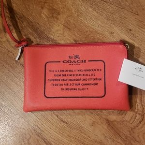 NWT Coach Wristlet came with a full size purse